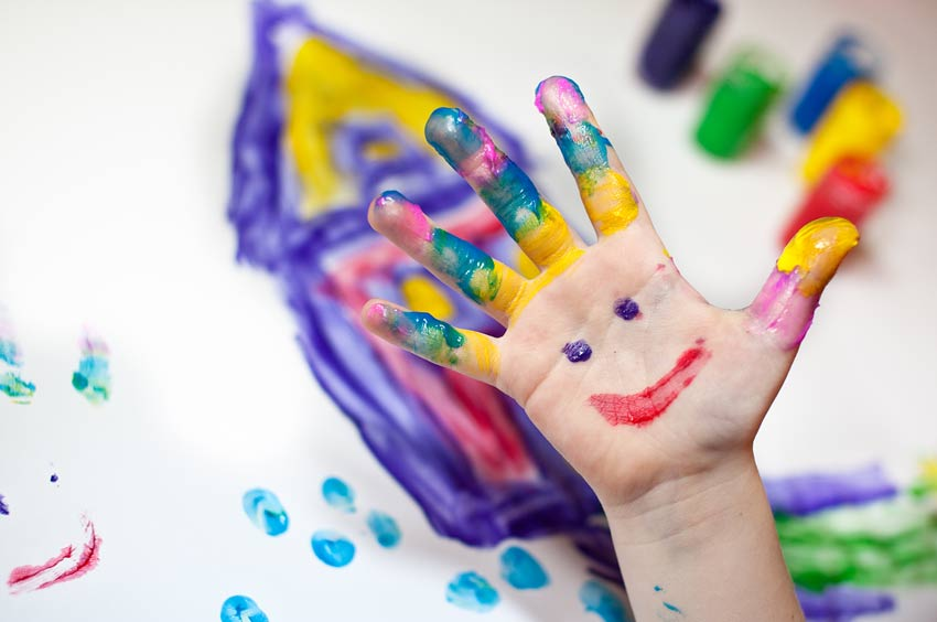 fingerpaint child's hand